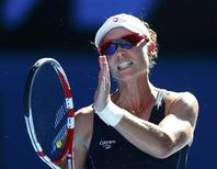 Samantha Stosur of Australia reacts during her women's singles match against Zheng Jie of China at the Australian Open tennis tournament in Melbourne, January 16, 2013. REUTERS/Daniel Munoz