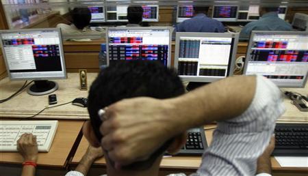 A broker looks at his terminal at a stock brokerage firm in Mumbai October 6, 2008. REUTERS/Arko Datta/Files