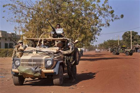 French Elite Special Operations soldiers drive through the town of Markala, about 275 km (171 miles) from the capital Bamako, January 15, 2013, to meet Malian soldiers and organize a counter-attack in the jihadist-held town of Diabaly. France will end its intervention in Mali only once stability has returned to the West African country, French President Francois Hollande said on Tuesday, raising the prospects of a costly, drawn-out operation against al Qaeda-linked rebels. REUTERS/Francois Rihouay