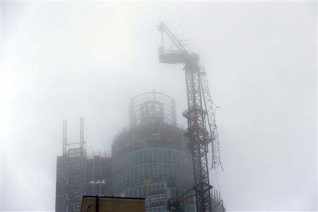 A damaged crane is seen on the St George's Tower in Vauxhall, south London January 16, 2013. REUTERS/Stefan Wermuth