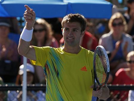 Tim Smyczek of the U.S. celebrates defeating Ivo Karlovic of Croatia in their men's singles match at the Australian Open tennis tournament in Melbourne, January 14, 2013. REUTERS/David Gray