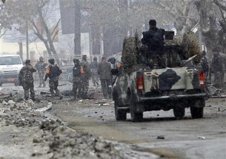 Afghan security forces investigate at the site of car bomb attack in Kabul January 16, 2013. REUTERS/Omar Sobhani