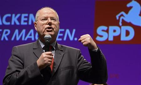 Peer Steinbrueck, Social Demrocratic (SPD) top candidate for the 2013 German general elections delivers his speech during an election campaign with Lower Saxony's Social Democratic top candidate Stephan Weil (not pictured) in Emden, January 4, 2013. REUTERS/Fabian Bimmer