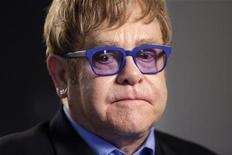 Musician Elton John pauses during an interview in Washington July 23, 2012. REUTERS/Kevin Lamarque