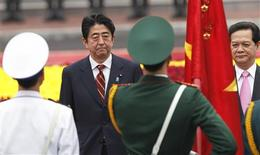 Japan's Prime Minister Shinzo Abe (L) and his Vietnamese counterpart Nguyen Tan Dung review the guard of honour during a welcoming ceremony at the Presidential Palace in Hanoi January 16, 2013. Abe is in Hanoi for a two-day visit to Vietnam, the first leg of his Asian tour to Vietnam, Thailand and Indonesia. The last time he was prime minister of Japan, Abe's inaugural foreign trip was to China. In the job again 7 years later and relations with Beijing now chilly, Abe is turning first this time to the rising economic stars of Southeast Asia. REUTERS/Kham/Pool