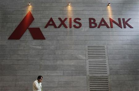 An employee speaks on his mobile phone as he walks inside Axis Bank's corporate headquarters in Mumbai July 17, 2012. REUTERS/Vivek Prakash/Files