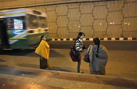 Commuters wait to get on a bus at the stop where police say a 23-year-old woman boarded and was subsequently raped by six people while the vehicle was moving on December 16, 2012, in New Delhi January 10, 2013. REUTERS/Mansi Thapliyal