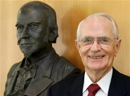 File picture of Walter Lange beside a bust of his great-grandfather Ferdinand Adolph Lange, founder of German watchmaker A. Lange & Soehne, in the eastern German town of Glashuette, south of Dresden December 8, 2005. REUTERS/Arnd Wiegmann