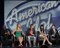 "Judges Randy Jackson (L-R), Mariah Carey, Keith Urban, Nicki Minaj and host Ryan Seacrest attend a Fox panel for the television series ""American Idol"" at the 2013 Winter Press Tour for the Television Critics Association in Pasadena, California January 8, 2013. REUTERS/Mario Anzuoni"