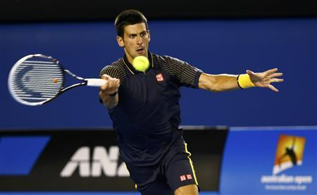 Novak Djokovic of Serbia hits a return to Ryan Harrison of the U.S. during their men's singles match at the Australian Open tennis tournament in Melbourne January 16, 2013. REUTERS/Daniel Munoz