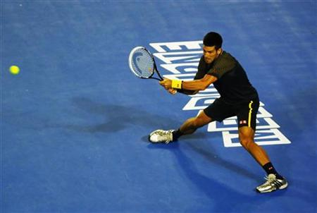 Novak Djokovic of Serbia hits a return to Ryan Harrison of the U.S. during their men's singles match at the Australian Open tennis tournament in Melbourne January 16, 2013. REUTERS/Daniel Munoz