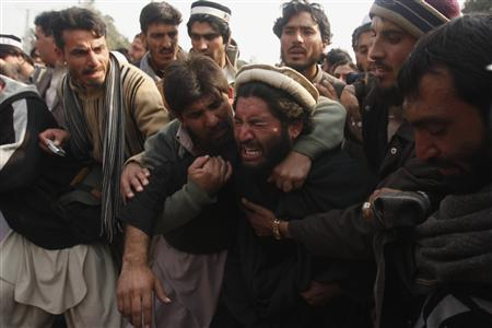 A tribesman mourns his relatives, who were said to have been killed after security forces had arrested them during a protest in front of government offices in northwestern city of Peshawar January 16, 2013. REUTERS/Fayaz Aziz