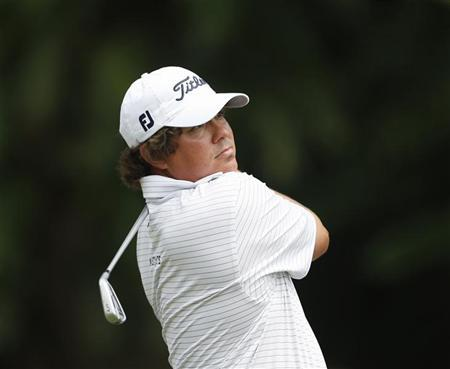Jason Dufner of the U.S. watches his shot on the first hole during the Malaysia's Asia Pacific Classic golf tournament in Kuala Lumpur October 25, 2012. REUTERS/Bazuki Muhammad