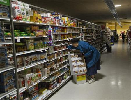 A woman looks for supplies at a Waldbaums grocery store in Long Beach, New York November 2, 2012. REUTERS/Shannon Stapleton