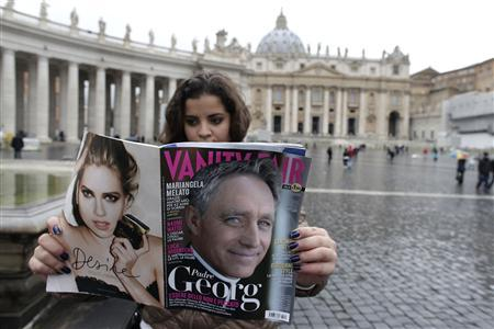 A woman holds a copy of Italy's Vanity Fair magazine showing Archbishop Georg Ganswein on the cover in St Peter's Square at the Vatican January 16, 2013. REUTERS/Tony Gentile
