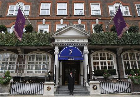 A doorman poses outside the Goring Hotel in London April 15, 2011. REUTERS/Luke MacGregor