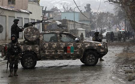 Afghan security forces keep watch after a car bomb attack in Kabul January 16, 2013. REUTERS/Omar Sobhani