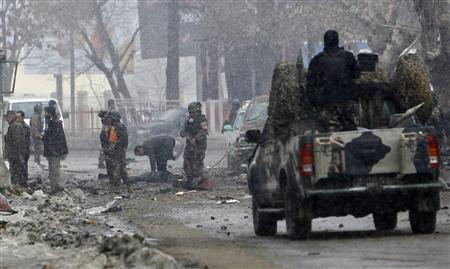 Afghan security forces investigate the site of a car bomb attack in Kabul January 16, 2013. REUTERS/Omar Sobhani
