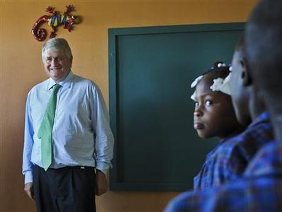 Digicel Chairman Denis O'Brien greets students of Julie Siskind School, which is financed by his company, in Port-au-Prince, in this picture taken December 19, 2012. REUTERS-Swoan Parker