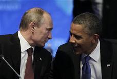 Президент России и США Владимир Путин и Барак Обама на саммите G20 в Лос-Кабосе, Мексика 18 июня 2012 года. Американская неправительственная организация Freedom House обвинила администрацию Барака Обамы в недостаточно жестком отклике на то, что правозащитники назвали новым наступлением государства на гражданское общество в России. REUTERS/Andres Stapff