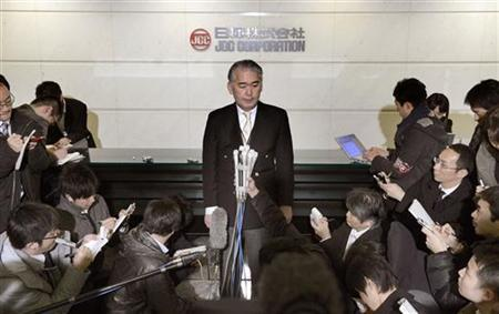 The Public Relations manager of JGC Corp Takeshi Endo answers reporters' questions regarding Japanese nationals who were kidnapped in Algeria, at its headquarters in Yokohama, south of Tokyo in this photo taken by Kyodo January 16, 2013. REUTERS/Kyodo