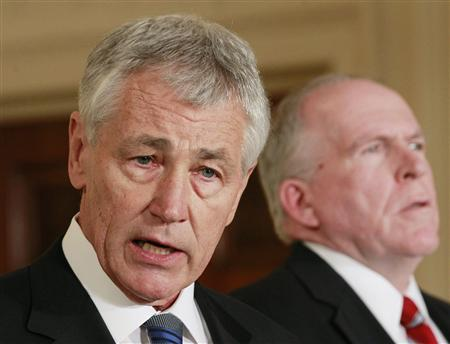 U.S. President Barack Obama's nominee for Secretary of Defense, former Senator Chuck Hagel (L), stands next to counterterrorism adviser John Brennan (R), the nominee for CIA Director, at the White House in Washington in this January 7, 2013 file photo. REUTERS/Jason Reed/Files