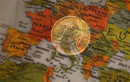 A picture illustration taken with the multiple exposure function of the camera shows a one Euro coin and a map of Europe, January 9, 2013. REUTERS/Kai Pfaffenbach (GERMANY - Tags: BUSINESS POLITICS)