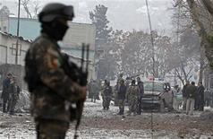 Afghan security forces investigate at the site of a car bomb attack in Kabul January 16, 2013. Six suicide bombers launched a coordinated attack on Afghanistan's spy agency in Kabul on Wednesday, killing at least two and wounding 22 others, Afghan officials said. REUTERS/Omar Sobhani (AFGHANISTAN - Tags: CIVIL UNREST)