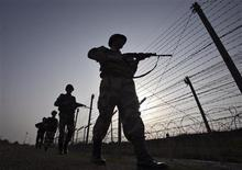 Indian Border Security Force (BSF) soldiers patrol the fenced border with Pakistan in Suchetgarh, southwest of Jammu January 16, 2013. Two Pakistani and two Indian soldiers were killed early this month in the worst outbreak of violence in Kashmir since India and Pakistan agreed a ceasefire nearly a decade ago. India and Pakistan have fought three wars since independence in 1947, two of them over the region both nations claim. REUTERS/Mukesh Gupta