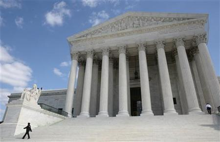 Security guards walk the steps of the Supreme Court in Washington, October 1, 2010. REUTERS/Larry Downing/Files