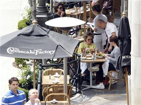 Patrons eat on a patio at The Cheesecake Factory restaurant in Glendale, California April 19, 2011. Cheesecake Factory Inc., will release its earnings on April 20. REUTERS/Fred Prouser/Files