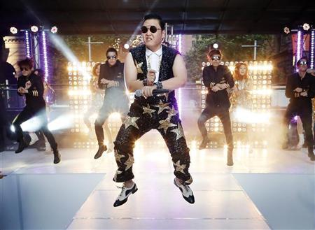 South Korean singer Psy performs his hit ''Gangnam Style'' during a morning television appearance in central Sydney October 17, 2012. REUTERS/Tim Wimborne
