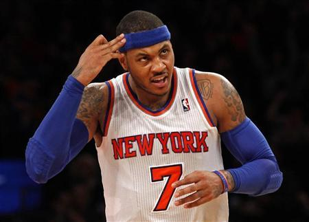 New York Knicks forward Carmelo Anthony reacts after hitting a three-point shot against the New Orleans Hornets in the second quarter of their NBA basketball game at Madison Square Garden in New York, January 13, 2013. REUTERS/Adam Hunger