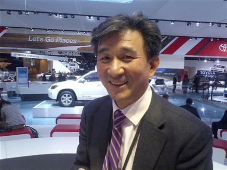 Yi Huang, chairman of Zhongsheng Group Holdings Ltd, a Chinese auto dealer group, attends the Detroit auto show in Detroit, Michigan, January 15, 2013. REUTERS/Bernie Woodall