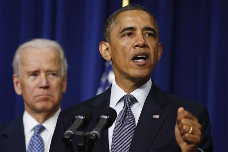 U.S. President Barack Obama (R) unveils a series of proposals to counter gun violence as Vice President Joe Biden looks on during an event at the White House in Washington, January 16, 2013. REUTERS/Larry Downing