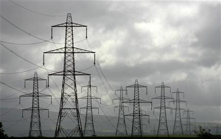 Electricity pylons are seen near Lancaster, northern England, July 11, 2006. REUTERS/Phil Noble