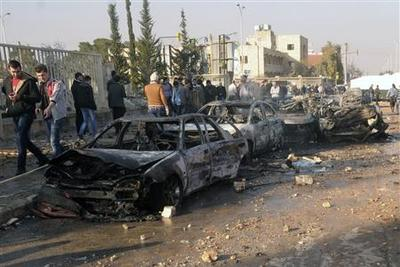 Coordinated car bombs kill 24 in north-west Syria