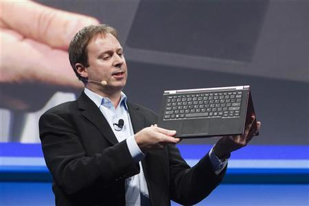 Kirk Skaugen, Intel's vice president of PC client group, converts a Lenovo Yoga Ultrabook into a tablet, at an Intel news conference during the Consumer Electronics Show (CES) in Las Vegas January 7, 2013. REUTERS/Steve Marcus