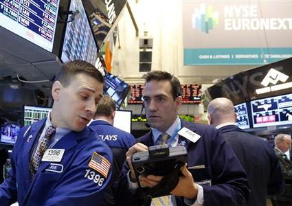 Traders work on the floor of the New York Stock Exchange, January 16, 2013. REUTERS/Brendan McDermid