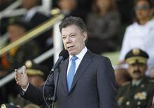 Colombian President Juan Manuel Santos gives a speech during a promotion ceremony at a police school in Bogota December 7, 2012. REUTERS/John Vizcaino