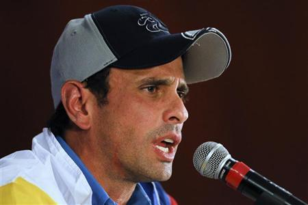 Venezuela's defeated opposition presidential candidate Henrique Capriles gives a news conference in Caracas October 9, 2012. REUTERS/Carlos Garcia Rawlins