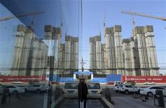 A construction site of a residential compound is reflected on the glass facades of a office building in Taiyuan, Shanxi province, January 15, 2013. REUTERS/Stringer
