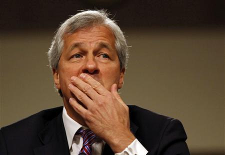 JP Morgan Chase and Company CEO Jamie Dimon pauses during a U.S. Senate Banking, Housing and Urban Affairs Committee hearing on Capitol Hill in Washington, in this June 13, 2012 file photo. JP Morgan Chase & Co's board of directors cut Chief Executive Dimon's annual bonus in half, citing the company's $6.2 billion ''London Whale'' trading loss, the company said January 16, 2013. REUTERS/Larry Downing/Files