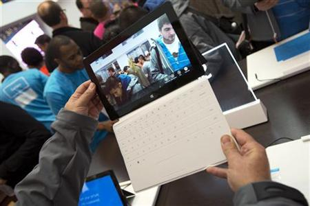 Sales staff demonstrate the Microsoft Surface during the opening of Microsoft's retail store in New York's Times Square October 25, 2012. REUTERS/Keith Bedford/Files