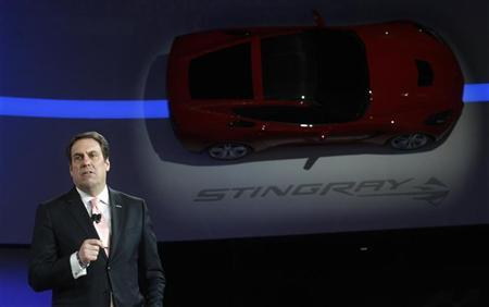 Mark Reuss, President for General Motors North America, speaks near a 2014 Chevrolet Corvette Stingray mounted on a wall at the North American International Auto Show in Detroit, Michigan January 14, 2013. REUTERS/Rebecca Cook