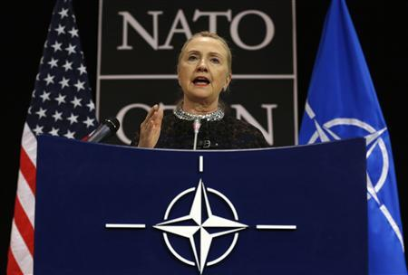 U.S. Secretary of State Hillary Clinton speaks during a news conference at the NATO headquarters in Brussels in this December 5, 2012 file photograph. REUTERS/Kevin Lamarque/Files