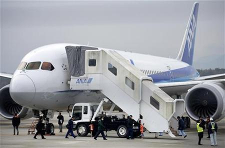Members of the Japan Transport Safety Board (JTSB) inspect All Nippon Airways' (ANA) Boeing Co's 787 Dreamliner plane, which made an emergency landing on Wednesday, at Takamatsu airport in Takamatsu, western Japan, in this photo taken by Kyodo January 17, 2013. REUTERS/Kyodo
