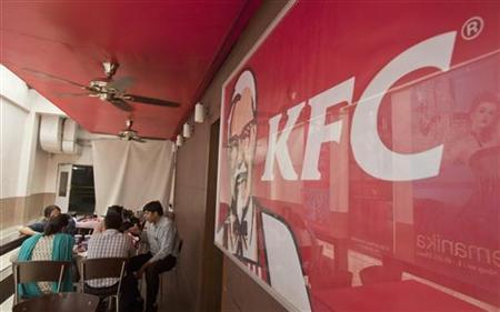 Customers eat at a KFC outlet, franchised by Yum Brands, in a suburban shopping mall in Mumbai February 22, 2012. REUTERS/Vivek Prakash/Files