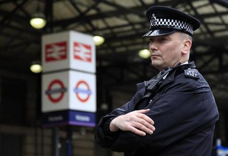 A police officer stands outside Victoria station central in London January 7, 2011. REUTERS/Stefan Wermuth/Files