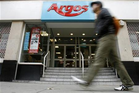 A pedestrian passes a branch of Argos in, central London October 19, 2008. REUTERS/Andrew Winning